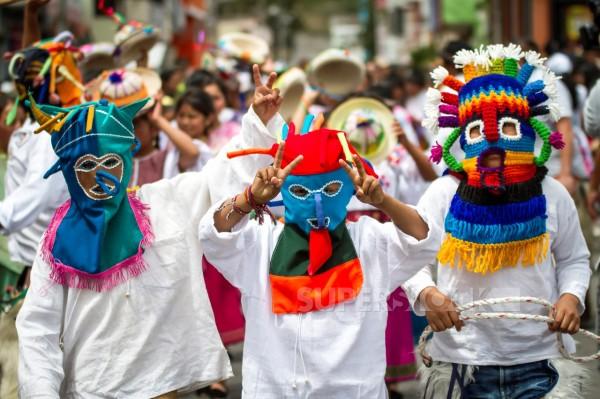 Inti Raymi children's parade, boys with mask Aya Uma.